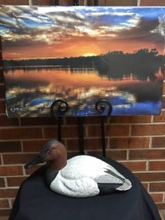 Photograph of Tecumseh lake by Walter Rose.  Hand carved Canvasback decoy by Lou Ott.