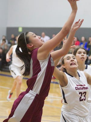 Katie Nachtrab of Charyl Stockwell Academy shoots in the game against Livingston Academy.