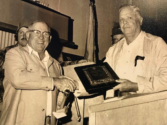 Edwin E. Sawyer Jr., right, received the Conservation