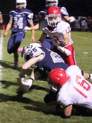 Silver's Trey Jameson dives across the endzone during Friday night action against Cobre. He tallied the first touchdown - a run from 14 yards out.