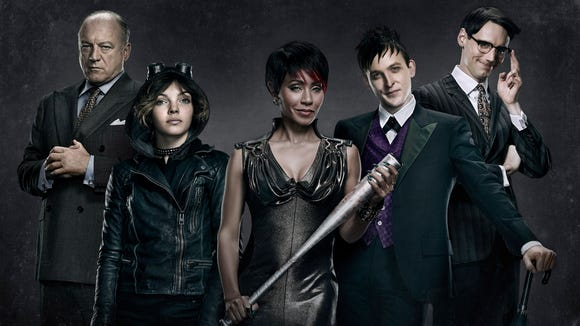 "Playing the villains on Fox's ""Gotham"" drama are (from left) John Doman as Carmine ""The Roman"" Falcone, Camren Bicondova as Selina Kyle (future Catwoman), Jada Pinkett Smith as Fish Mooney, Robin Lord Taylor as Oswald Cobblepot (future Penguin) and Cory Michael Smith as Edward Nygma (future Riddler).  Provided/Fox"