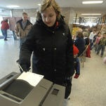 Amy Masanz records her vote at Weston Elementary School.