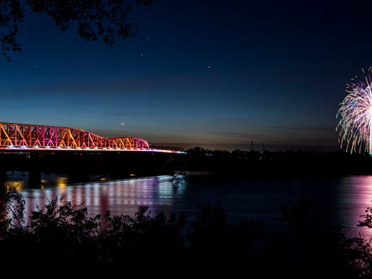 October 22, 2016 - Fireworks explode over Arkansas farm fields as the the Big River Crossing bridge is lit for the first time. The new boardwalk which allows cyclists and walkers to cross the river alongside Union Pacific Railroad freight trains on a 100-year-old bridge is now the longest public cycling and walking bridge over the Mississippi.