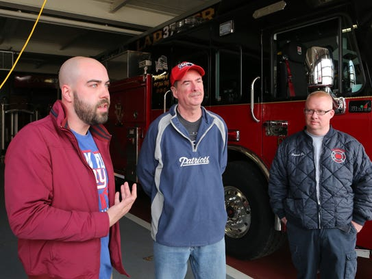 Mike Chillemi, left, talks about starting a gofundme page to send family friend Bill Duggan, center, of Mount Kisco, a longtime member of the Tarrytown Fire Department and former Valhalla fire chief, to the Super Bowl. Duggan was recently diagnosed with Stage 4 brain cancer.