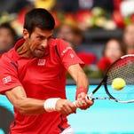 Novak Djokovic of Serbia plays a backhand against Roberto