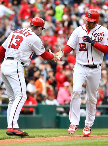 Apr 29, 2018; Washington, DC, USA; Washington Nationals catcher Matt Wieters (32) is congratulated by third base coach Bob Henley (13) after hitting a solo home run against the Arizona Diamondbacks during the second inning at Nationals Park. Mandatory Credit: Brad Mills-USA TODAY Sports