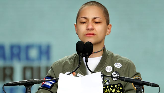 Tears roll down the face of Marjory Stoneman Douglas High School student Emma Gonzalez as she observes 6 minutes and 20 seconds of silence while addressing the March for Our Lives rally on March 24 in Washington.