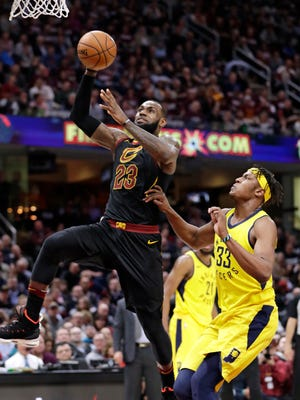 The Cleveland Cavaliers' LeBron James drives to the basket against the Indiana Pacers' Myles Turner during the first half.