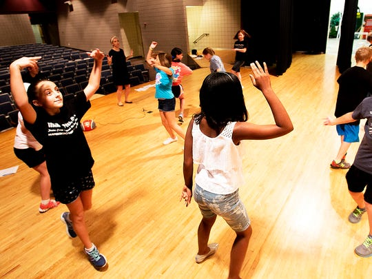Theatre Campers express themselves as they move in a circle and listen to the music as they practice for an end of the week performance.photo by Jim Davis/Murfreesboro Parks & Rec.
