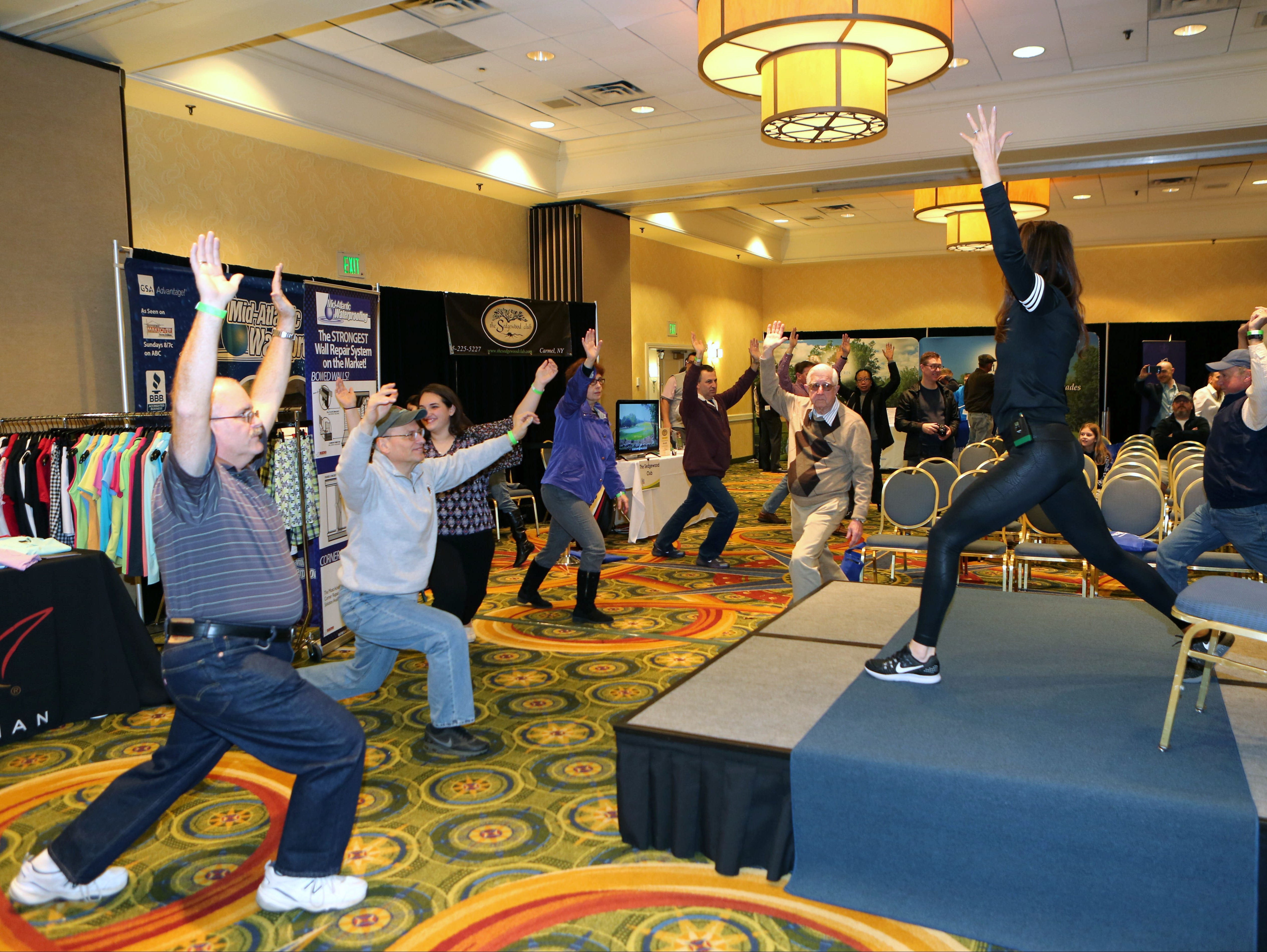 Yoga Instructor Karen Young puts the attendees through some moves at the lohud.com Golf Show at the Westchester Marriott in Tarrytown, March 12, 2016. The show continues Sunday, March 13, 2016 from 9:00 a.m. till 4:00 p.m.