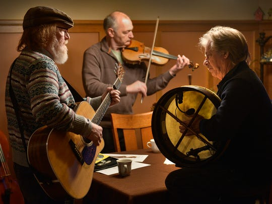 Ring of Kerry members Charlie Roth, from left, Paul Imholte, and Paul Cotton practice at Imholte's St. Cloud home in this March 2015 photo.