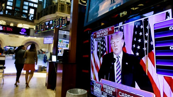 A television screen Donald Trump speaking during a