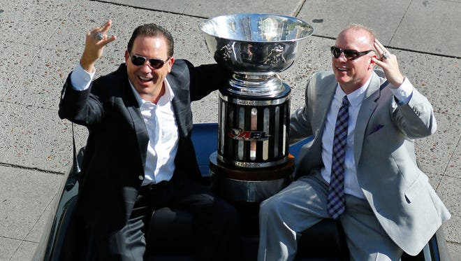 Arizona Rattlers owner Ron Shurts (left) and head coach Kevin Guy take part in their victory parade on Aug. 27, 2014 in Phoenix.