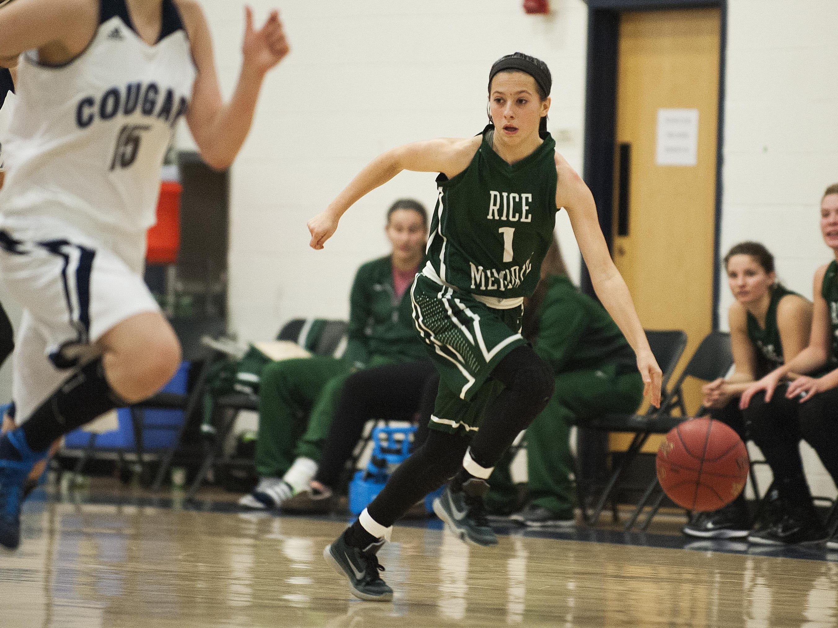 Rice guard Leah Larivee (1) dribbles the ball down the court during the girls basketball game between the Rice Green knights and the Mount Mansfield Cougars at MMU High School on Friday night December 4, 2015 in Jericho.