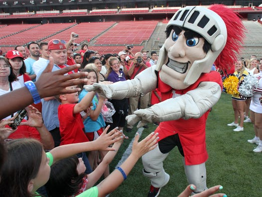 Rutgers is throwing a free party for fans to celebrate its official entry into the Big Ten. Big Ten Commissioner Jim Delany, Rutgers President Robert Barchi and Athletic Director Julie Hermann will speak at the celebration. It will feature coach and student-athlete interaction, the cheer and dance squads, the Rutgers Marching Band, and live music. A multitude of activities will be set up on the field for guests to enjoy. Celebration ends with a fireworks display at 9 p.m  Rutgers Scarlet Knight mascot greets the fans.    On Tuesday July 1,2014 Photo: Mark R. Sullivan/Staff Photographer