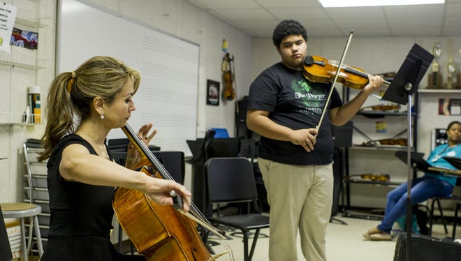 Cellist Allison Eldredge leads a master class hosted by the Acadiana Symphony Orchestra & Conservatory of Music for Lafayette High School String Ensemble students in Lafayette, La., Friday, March 20, 2015.