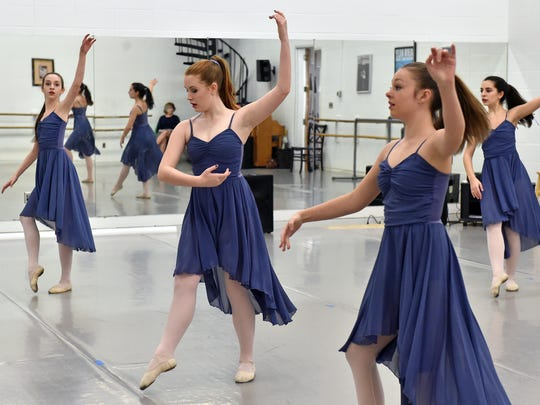 """Ballet Mississippi dancers perform during a rehearsal of """"Let The Music Dance,"""" which they will be performing with musician Claire Holley Saturday at Duling Hall in Jackson."""
