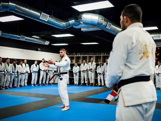 Mike Carbullido gives a speech to his teammates and peers after receiving his black belt in jiu-jitsu