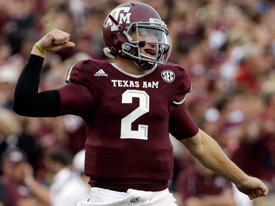 Texas A&M quarterback Johnny Manziel (2) celebrates after throwing a touchdown pass to Malcome Kennedy against Mississippi State.