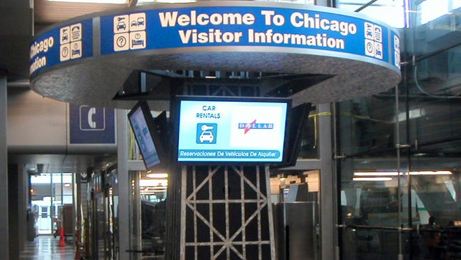 """A """"welcome"""" sign greets arrivals to Chicago O'Hare International Airport in 2006."""