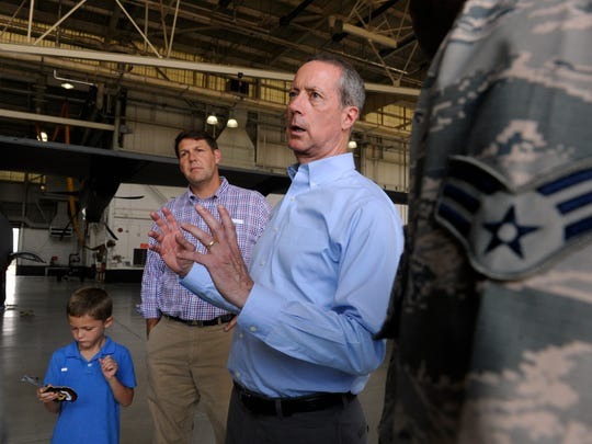 U.S. Representative Mac Thornberry (District 13) speaks with Dyess Air Force Base airmen during a tour of the base Thursday August 3, 2017. Behind him is District 17 Representative Jodey Arrington, standing with his 6 year-old son Nathan. Thornberry is chairman of the House Armed Services Committee.