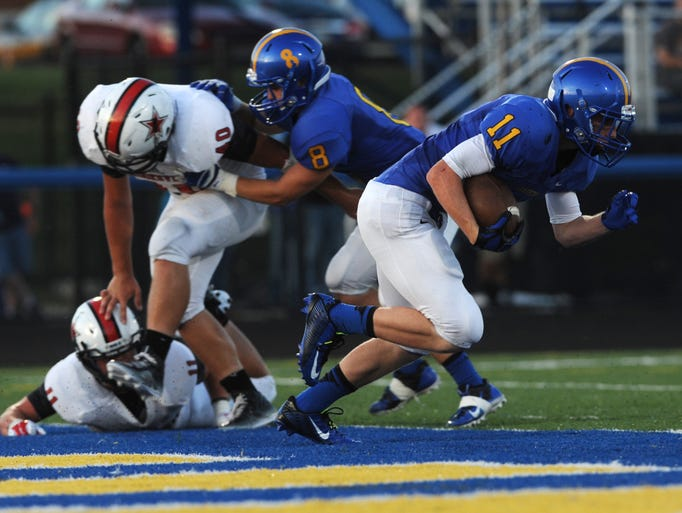 Maysville's Couger Clarke starts his race from one end zone to the other after incepting a Crooksville pass and returning it for a touchdown Thursday night at Maysville Athletic Complex.