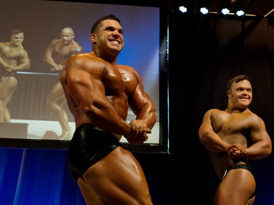 """Professional bodybuilder Derek Lunsford and Collin Clarke have a """"pose-off"""" during Indiana Muscle in March of 2018. Lunsford is as big a fan of Collin as Collin is of him. Wayne Williams, also a professional, also took part in the moment. It was one of the best birthday presents the 25-year-old had ever received."""