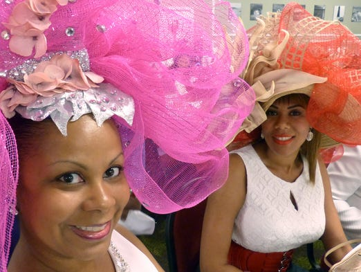 "(l-r)  Jill Mills and Tia Rogers bothed wowed the crowd and impressed judges with their hats Sunday afternoon during the 14th annual Scholarship ""It's All About Pizzazz!!!"" Hat Show and Luncheon put on by the Pensacola Chapter of the National Coalition of 100 Black Women, Inc. The event was held at New World Landing.For this story and more stories and photos, see the September issue of Pensacola Bella Magazine, and go to www.BellaMagazine.com"