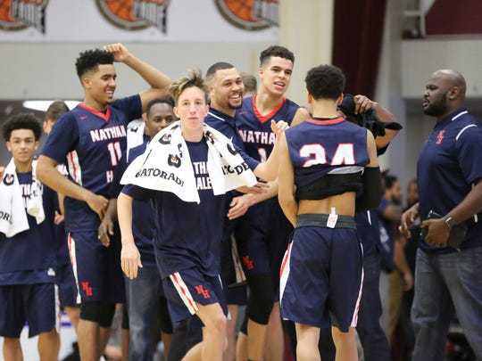Nathan Hale players and coach Brandon Roy, center, celebrate a victory against Oak Hill Academy (Va.) during  the 2017 Hoophall Classic last week in Springfield, Mass. The Raiders won 80-77 to remain undefeated.