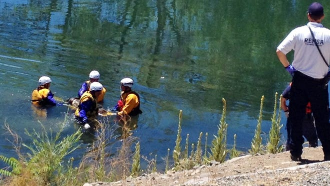 Reno and Sparks firefighters are pulling a body found floating face down on the Truckee River. The name and age of the person is unknown.