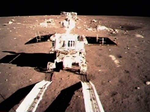 In this image taken by the on-board camera of the lunar probe Chang'e-3 and made off the screen of the Beijing Aerospace Control Center in Beijing, China's first moon rover