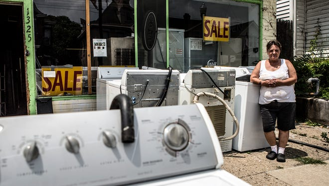 """Maggie Diles, 53, has heard sexist """"back in our day"""" comments from men. But in some ways, she can understand a longing for the old days, when her family's used appliance store had better sales."""