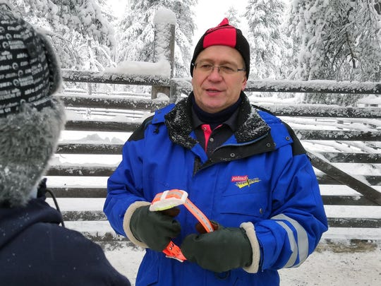 Matti Sarkela from Finland's Reindeer Herding Association holds an internet-connected reindeer collar, that can connect to a smartphone to locate roaming reindeer in Finnish Lapland, in Rovaniemi, Finland.