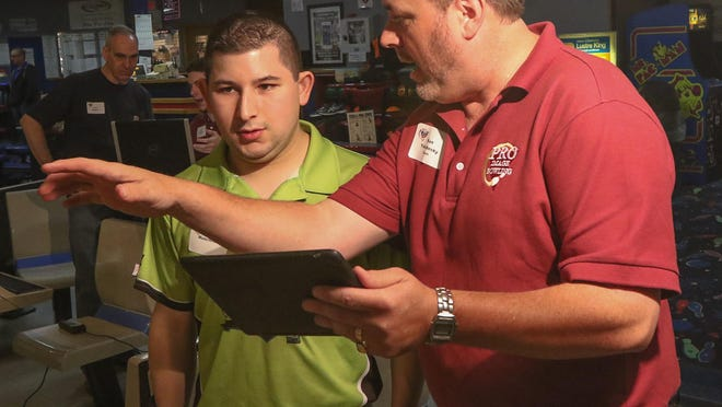 Ken Yokobosky, right, works with Ryan Musciotto of Northvale at Rockaway Lanes' three-day Bowling Boot Camp last month.