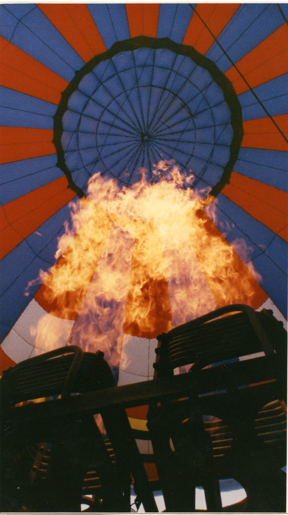 An eight-story balloon, a tank of propane and a burner