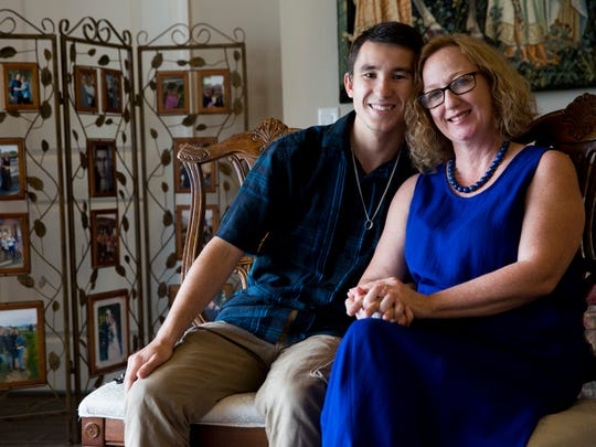 "Spenser Luther, 19, with his adoptive mother, Melissa Luther, at their home Thursday, June 29, 2017 in East Naples. After a year-plus of planning, Luther and his adoptive mother made the trip to his hometown of Tobolsk, Russia, to meet his brother Oleg, 30, and sister Alyona, 29, for the first time. The trip provided a lot of closure for Luther. ""There wasn't a day that has gone by that I thought, 'Who am I?'"" Luther said. ""It's almost like finding a buried treasure."""