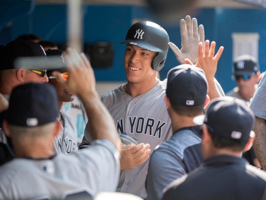 New York Yankees right fielder Aaron Judge (99) celebrates