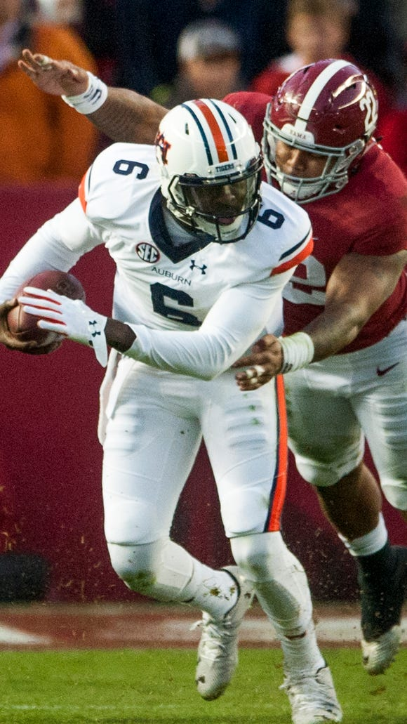 Auburn quarterback Jeremy Johnson (6) is sacked by Alabama linebacker Ryan Anderson (22) during the Iron Bowl at Bryant Denny Stadium in Tuscaloosa, Ala. on Saturday November 26, 2016. (Mickey Welsh / Montgomery Advertiser)