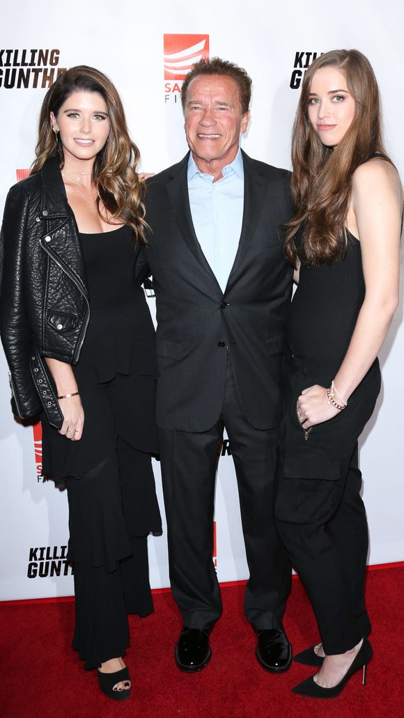 Katherine Schwarzenegger, left, with her dad, Arnold