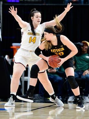Iowa forward Megan Gustafson (right) had a record-setting day at the Big Ten women's basketball tournament Friday.