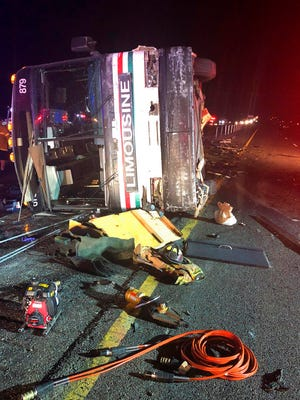 A bus remains on the scene of a multi-vehicle deadly crash Sunday, July 15, 2018, on Interstate 25 just north of Bernalillo.