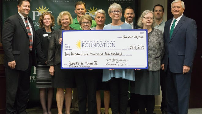 Suzanne Kahn, center left, and Dorothy Kahn Galloway, center right, presented Pensacola State College with a $201,200 scholarship Tuesday morning.