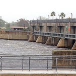 Water rushes through the gates on the Caloosahatchee River at the Franklin locks in Olga. Discharges from Lake Okeechobee are fouling downstream estuaries at the height of tourist season. (Eric Staats/staff)