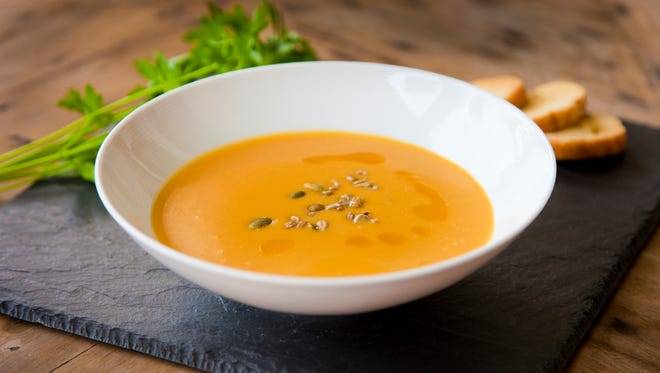 Thai inspired butternut squash and peanut soup with red bell pepper, lime, cilantro