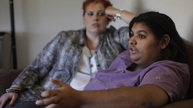 Cynthia Shouse, right, of Cedar Rapids, who has been diagnosed with schizophrenia and Asperger's syndrome, has had to wait more than two days in a hospital emergency department while staff members try to find an open psychiatric unit bed anywhere in the state. She is shown with her mother, Rhonda Shouse.