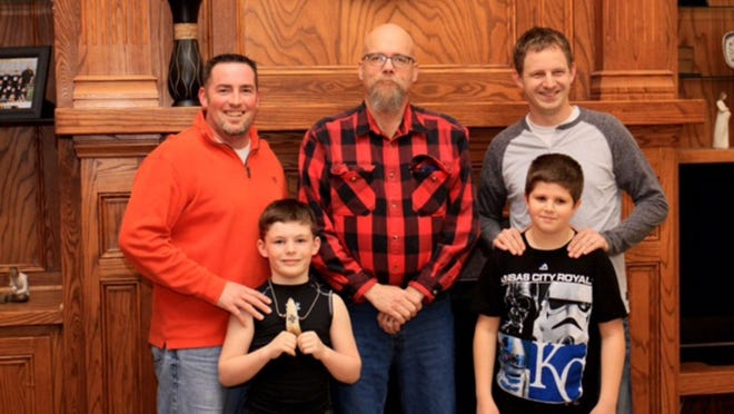 Damian Bell, left, with his son, Konnor; Richard G. Rauzi, center; and Jesse Bannor and his son, Ethan.