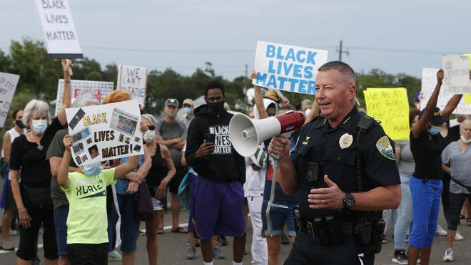 "New Smyrna Beach Chief of Police Mike Coffin addresses the crowd during a protest march to the top of the Martin Luther King Jr. Bridge in New Smyrna Beach on Monday. ""I'll tell you this. Nobody, nobody hates bad cops more than good cops,"" Coffin said."
