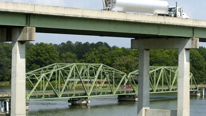 Northbound traffic on Alabama Highway 77 crosses the old Southside bridge, bottom, which opened in 1939, as southbound traffic heads across the new bridge.