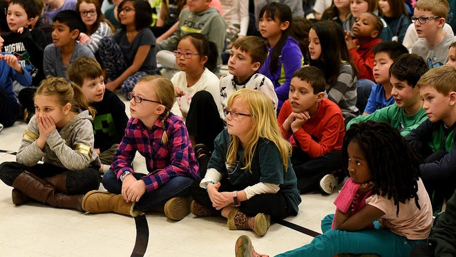 Students in Mount Laurel will now have the opportunity to attend full-day kindergarten in the district. Above, experiments on electricity got the students' attention at Countryside Elementary School in Mount Laurel.