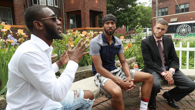 Davonta'e Winchester, 19, from left, Shawn Mansfield, 28, and Ryan Stull, 30, talk about what they want to accomplish through community protests during an interview Wednesday in Akron's Highland Square.